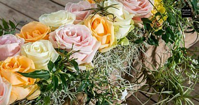 Soft Pastel-Coloured Roses At The Table